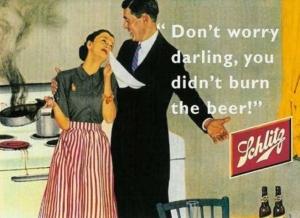 Uma mulher bem vestida, chorando porque queimou a comida, mas o seu herói a consola, vamos tomar cerveja e está tudo bem.